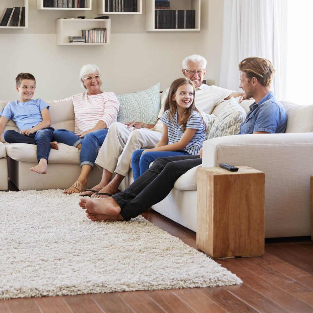 Family enjoying in living room | Home Lumber & Supply